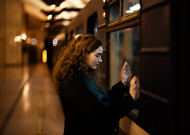 Alexandra Bochkareva SAD WOMAN LEANING AGAINST TRAIN Women
