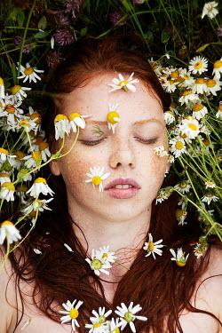 Alexandra Bochkareva WOMAN SLEEPING AMONG DAISIES Women