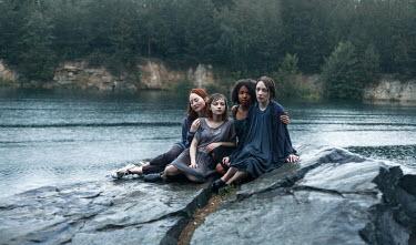 Dmitriy Bilous FOUR WET TEENAGE FRIENDS SITTING ON ROCK Women