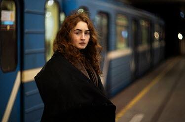 Alexandra Bochkareva WOMAN STANDING ON RAILWAY PLATFORM Women