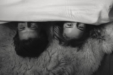 Dmitriy Bilous HAPPY COUPLE ON SHEEPSKIN RUG FROM ABOVE Couples