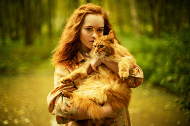 Alexandra Bochkareva WOMAN HOLDING CAT IN WOODS Women