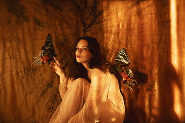 Aleah Ford WOMAN SITTING WITH LARGE BUTTERFLIES Women