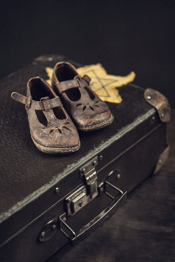Magdalena Russocka child's shoes and star of david on suitcase