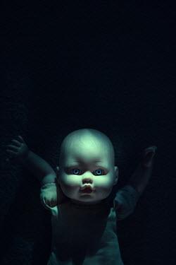 Magdalena Russocka creepy doll lying on floor at night