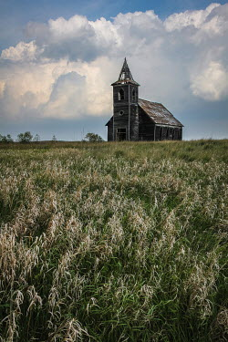 Rodney Harvey DERELICT WOODEN CHURCH IN SUMMERY FIELD Religious Buildings