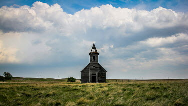 Rodney Harvey DERELICT CHURCH IN FIELD WITH CLOUDS Religious Buildings