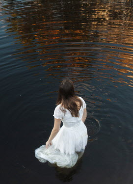 Aleah Ford WOMAN IN DRESS STANDING WATER Women