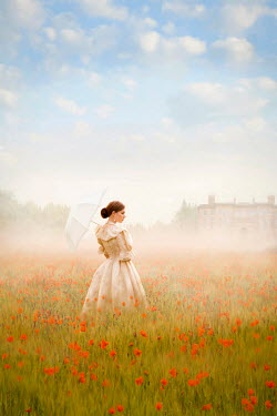Lee Avison victorian woman standing in a poppy meadow at dawn Women