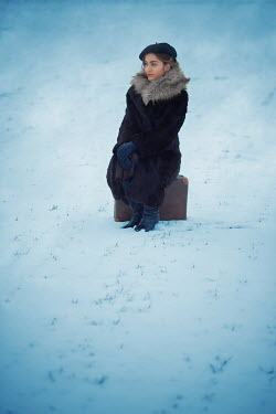 Ildiko Neer VINTAGE GIRL SITTING ON SUITCASE IN SNOW Women