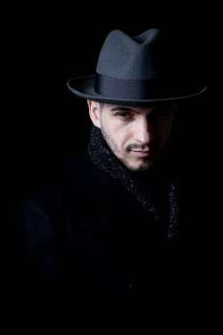 Miguel Sobreira MAN IN SHADOW IWTH HAT AND SCARF Men