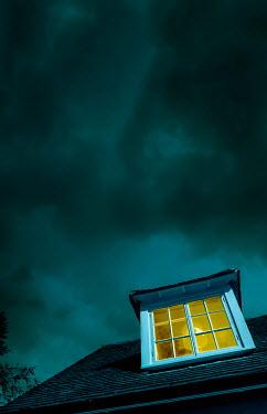 Stephen Mulcahey A loft room light on at nightime