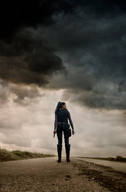 Stephen Mulcahey POLICEWOMAN ON COUNTRY ROAD IN STORM Women
