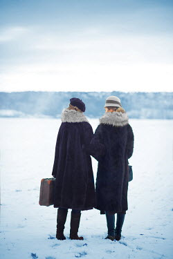 Ildiko Neer Two vintage women in the snow Women