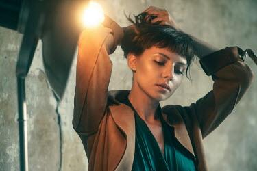 Maria Yakimova WOMAN IN COAT BY GLOWING LAMP Women