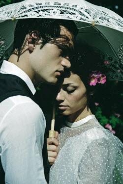 Giovan Battista D'Achille BRIDE AND GROOM OUTDOORS UNDER PARASOL Couples