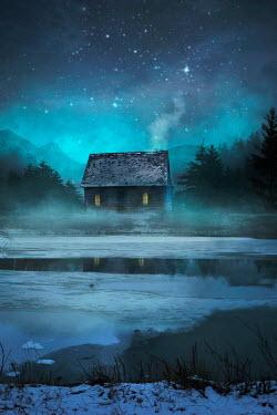 Drunaa Cabin on lake in winter