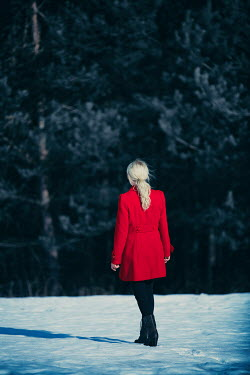 Magdalena Russocka woman wearing red coat standing in snowy field