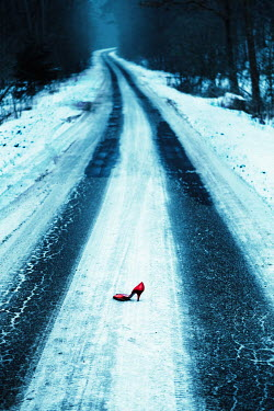 Magdalena Russocka red high heel shoe abandoned on country road in winter