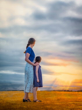 Mary Wethey MOTHER AND DAUGHTER IN FIELD AT SUNSET Women