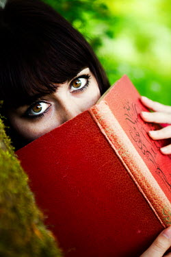 Ebru Sidar CLOSE UP OF WOMAN HOLDING RED BOOK Women