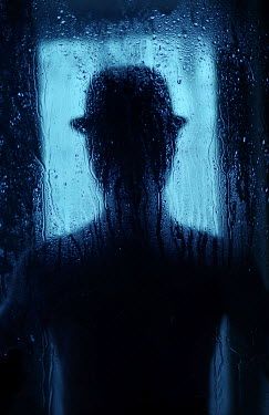 Svitozar Bilorusov SILHOUETTED MAN IN HAT BEHIND WET WINDOW Men