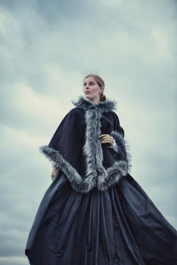 Magdalena Russocka historical woman with cape outdoors Women