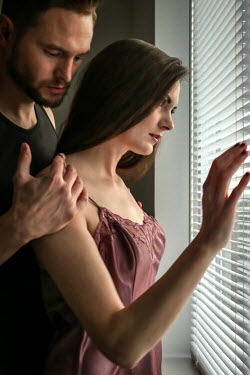 Stephen Carroll INTIMATE COUPLE STANDING BY WINDOW Couples