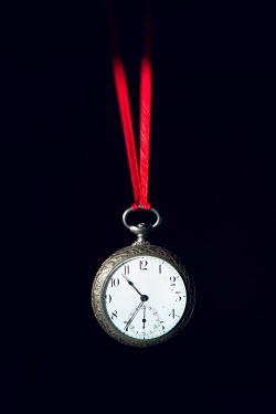 Magdalena Russocka antique pocket watch hanging on red ribbon