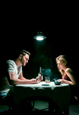 Stephen Carroll COUPLE PLAYING CARDS AT NIGHT INDOORS Couples