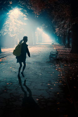 Lee Avison schoolgirl running at night in fog