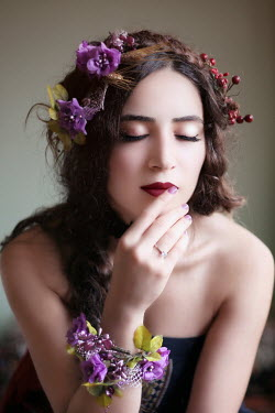 Kamil Akca WOMAN WEARING PURPLE FLORAL HEADDRESS Women