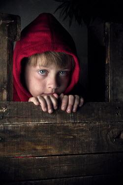 Kelly Sillaste BOY LOOKING THROUGH WOODEN DOOR Children