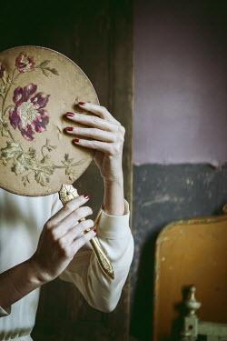 Monia Merlo WOMAN HOLDING OLD FLORAL MIRROR Women