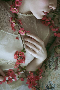 Monia Merlo CLOSE UP OF WOMAN WITH PINK BLOSSOM Women