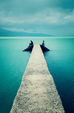 Nilufer Barin TWO PEOPLE SITTING ON CONCRETE JETTY Men