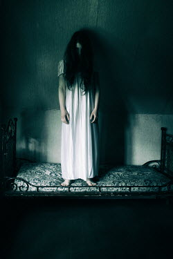 Magdalena Russocka eerie girl standing on bed in attic Women