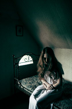 Magdalena Russocka sad girl sitting on bed in attic Women