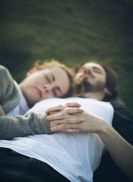 Mark Owen YOIUNG COUPLE SLEEPING ON GRASS Couples