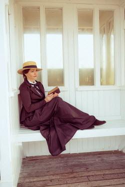Nic Skerten HISTORICAL WOMAN WITH BOOK SITTING ON PIER Women