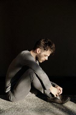 Giovan Battista D'Achille MAN SITTING TYING SHOELACES IN SHADOW Men