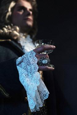 Ysbrand Cosijn CLOSE UP OF HISTORICAL MAN HOLDING GLASS Men