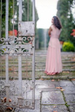 Nikaa WOMAN IN GARDEN WITH OPEN GATE Women