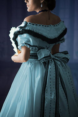 Ildiko Neer Victorian woman in blue ball gown holding a fan