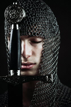 Magdalena Russocka young medieval man with chainmail and sword