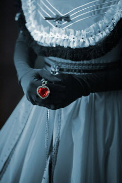 Ildiko Neer Victorian woman holding heart necklace