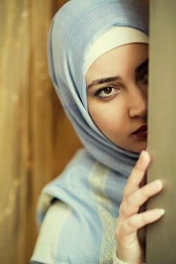 Mohamad Itani MUSLIM WOMAN PEERING OUT OF DOORWAY Women