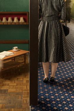 Colin Hutton RETRO WOMAN IN OFFICE CORRIDOR Women