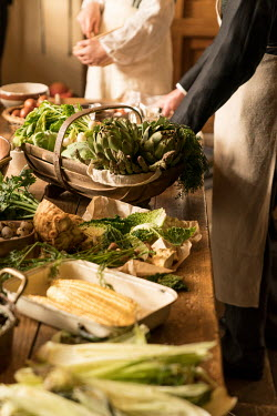 Colin Hutton VINTAGE KITCHEN WITH COOKS PREPARING FOOD Men