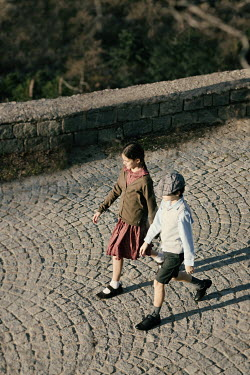 Krasimira Petrova Shishkova vintage boy and girl walking on cobbled street